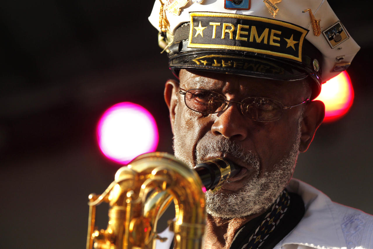 Roger Lewis, with the Treme Brass Band, performs at a sunrise concert marking International Jazz Day in New Orleans, Monday, April 30, 2012. The performance, at Congo Square near the French Quarter, is one of two in the United States Monday; the other is in the evening in New York. Thousands of people across the globe are expected to participate in International Jazz Day, including events in Belgium, France, Brazil, Algeria and Russia. (AP Photo/Gerald Herbert)