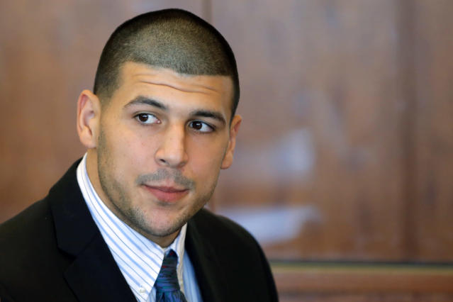 FILE - In this Oct. 9, 2013, file photo, former New England Patriots NFL football player Aaron Hernandez attends a pretrial court hearing in superior court in Fall River, Mass. Judge Susan Garsh rejected a request Friday, Feb. 7, 2014, by prosecutors in Hernandez's murder case for his jailhouse phone recordings, then ordered them to turn over to the defense copies of calls they acknowledged already having. (AP Photo/Brian Snyder, Pool, File)