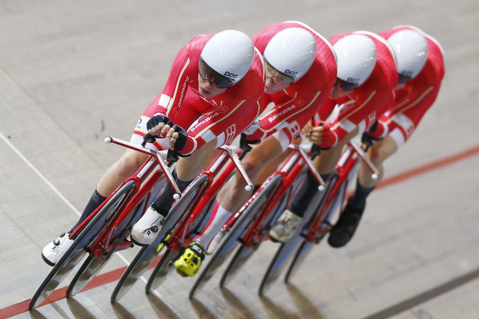 Silver medalists Team Denmark with Niklas Larsen, Julius Johansen, Frederik Madsen and Casper von Folsach competes during the final of the men's team pursuit at the World Championships Track Cycling in Apeldoorn, eastern Netherlands, Netherlands, Thursday, March 1, 2018. (AP Photo/Peter Dejong)