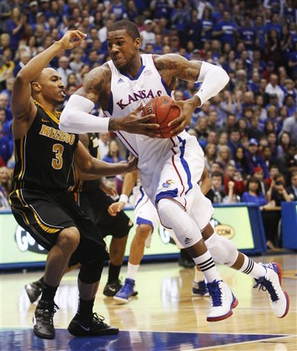 Kansas forward Thomas Robinson (0) drives on Missouri guard Matt Pressey (3) during the first half of an NCAA college basketball game in Lawrence, Kan., Saturday, Feb. 25, 2012. (AP Photo/Orlin Wagner)