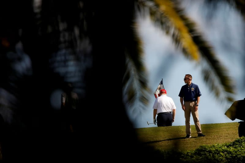 U.S. President Donald Trump plays golf at the Trump National Golf Club in West Palm Beach