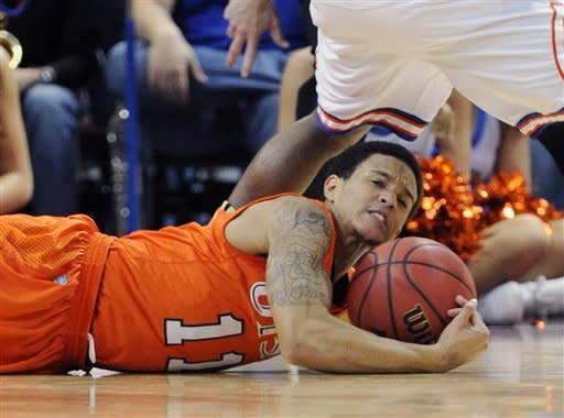 UTSA's Michael Hale III (11) grabs a loose ball during the first half of a Western Athletic Conference tournament NCAA college basketball game against UT Arlington, Friday, March 15, 2013 in Las Vegas. (AP Photo/David Becker)
