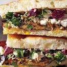 "Meatless doesn't mean dainty. This <a href=""https://www.epicurious.com/recipes-menus/meatless-vegetarian-recipes-winter-gallery?mbid=synd_yahoo_rss"" rel=""nofollow noopener"" target=""_blank"" data-ylk=""slk:vegetarian"" class=""link rapid-noclick-resp"">vegetarian</a> powerhouse from Brooklyn's Saltie balances salty feta and olives with a salad-like mix of fresh herbs. Plenty of pickled, vinegary ingredients (this one uses capers and pickled beets, but any pickled veg would work) keep the full-flavored components bright. <a href=""https://www.epicurious.com/recipes/food/views/roasted-eggplant-and-pickled-beet-sandwiches-51155480?mbid=synd_yahoo_rss"" rel=""nofollow noopener"" target=""_blank"" data-ylk=""slk:See recipe."" class=""link rapid-noclick-resp"">See recipe.</a>"
