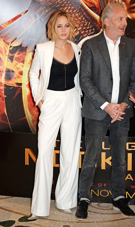 "<p>The girl on fire looked white hot in a pants suit and black camisole at the photo call for ""The Hunger Games: Mockingjay Part 1"" in London in 2014. (Photo: Dave M. Benett/WireImage) </p>"