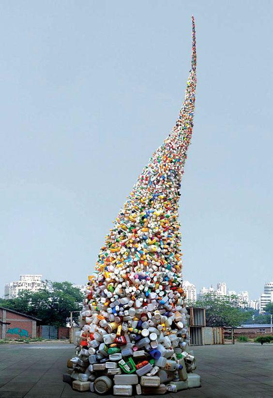 """<p>This is the smartest dump we have ever seen. Bejing artist Wang Zhiyuan created this incredible tower out of trash.<a href=""""https://uk.pinterest.com/pin/170855379583461277/""""><i> [Photo: Pinterest]</i></a></p>"""