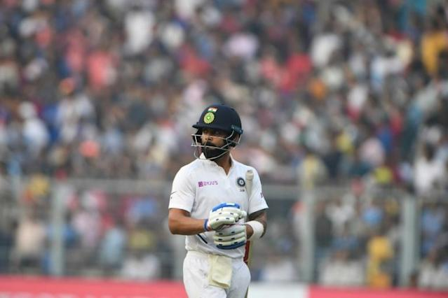 India's captain Virat Kohli could scarcely believe his eyes after being caught down fine leg for 136 against Bangladesh in Calcutta (AFP Photo/Dibyangshu SARKAR)