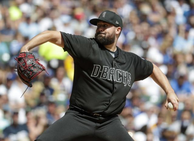 Arizona Diamondbacks starter Robbie Ray throws during the first inning of a baseball game against the Milwaukee Brewers Sunday, Aug. 25, 2019, in Milwaukee. (AP Photo/Morry Gash)