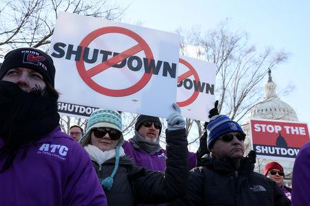 Federal air traffic controller union members protest the partial U.S. federal government shutdown in a rally at the U.S. Capitol in Washington