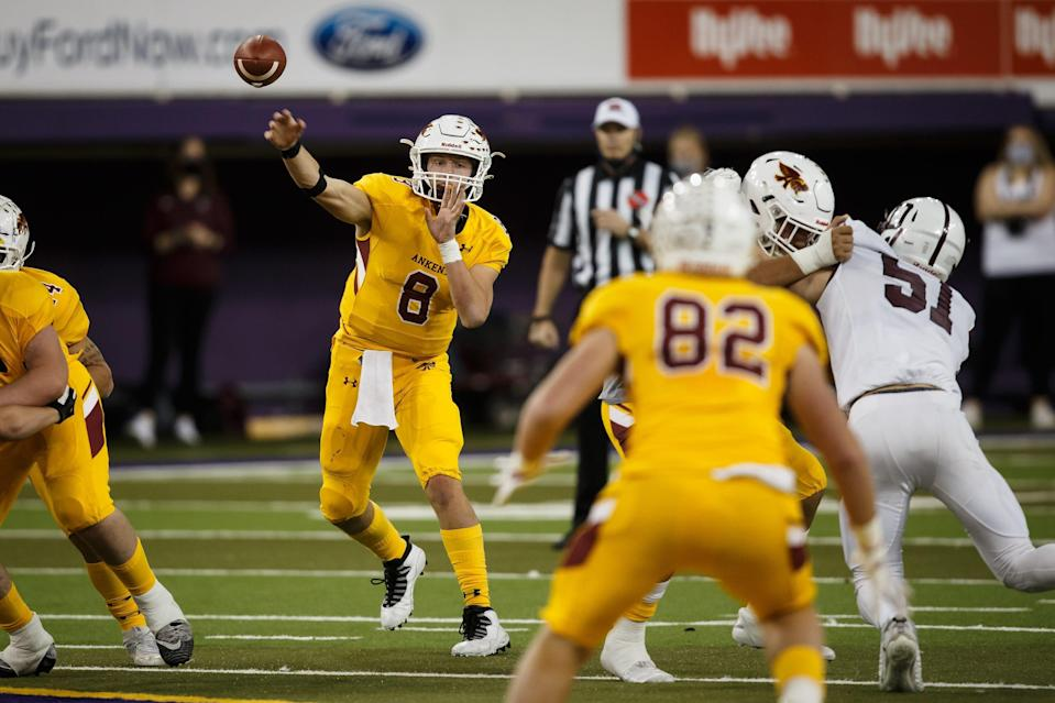 Ankeny's Jase Bauer (8) passes to Ankeny's Weston Fulk (82) during their 4A Iowa high school state championship semi-final game at the UNI-Dome on Friday, Nov. 13, 2020, in Cedar Falls, IA. Ankeny would go on to defeat Dowling Catholic 31-24 in overtime.