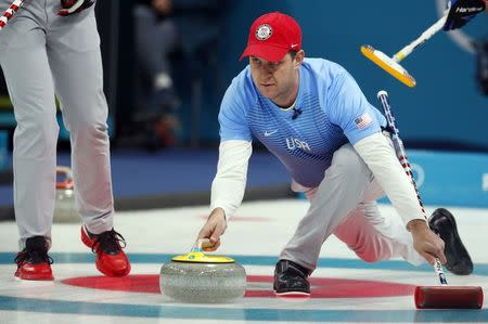 Curling - Pyeongchang 2018 Winter Olympics - Men's Semi-final - Canada v U.S. - Gangneung Curling Center - Gangneung, South Korea - February 22, 2018 - Skip John Shuster of the U.S. delivers the stone. REUTERS/Phil Noble