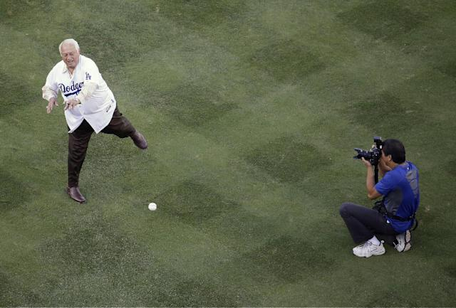 Former Los Angeles Dodgers manager Tommy Lasorda throws out the ceremonial first pitch before Game 4 of the National League baseball championship series against the St. Louis Cardinals, Tuesday, Oct. 15, 2013, in Los Angeles. (AP Photo/Morry Gash)
