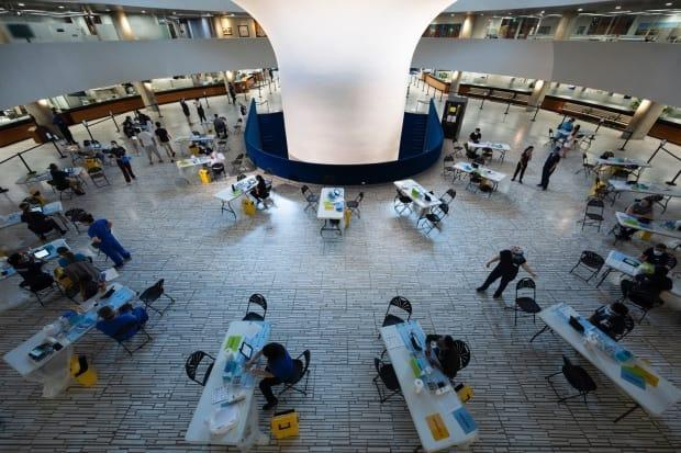 Mayor John Tory tweeted his photo of a pop-up vaccination clinic in the rotunda of city hall on Sunday. (John Tory/Twitter - image credit)