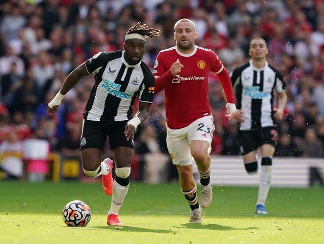 Luke Shaw, right, has started in all four of Manchester United's Premier League games this season