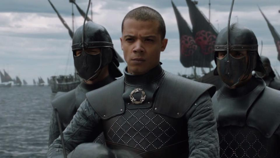 Grey Worm is flanked by two soldiers in Game of Thrones