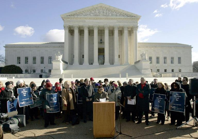 Norma McCorvey (C-Podium), the Roe of Roe v. Wade, speaks on the steps of the US Supreme Court on January 18, 2005 after petitioning the court to reverse its landmark decision that granted women the right to an abortion