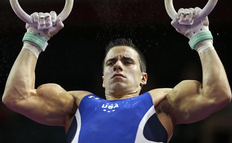 Jacob Dalton, of the United States, performs on the rings during the American Cup gymnastics competition in Worcester, Mass., Saturday, March 2, 2013. (AP Photo/Charles Krupa)