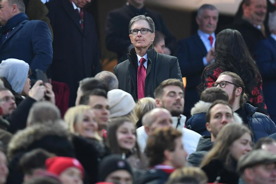 Liverpool's US owner John W. Henry (C) attends the English Premier League football match between Liverpool and Manchester United at Anfield stadium in Liverpool, north west England on January 19, 2020. (Photo by Paul ELLIS / AFP) / RESTRICTED TO EDITORIAL USE. No use with unauthorized audio, video, data, fixture lists, club/league logos or 'live' services. Online in-match use limited to 120 images. An additional 40 images may be used in extra time. No video emulation. Social media in-match use limited to 120 images. An additional 40 images may be used in extra time. No use in betting publications, games or single club/league/player publications. /  (Photo by PAUL ELLIS/AFP via Getty Images)