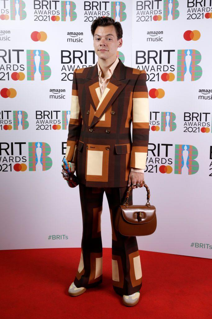 <p>Styles wore a 1970s-style suit and bamboo handle handbag with his Mastercard British Single award for 'Watermelon Sugar'.</p>