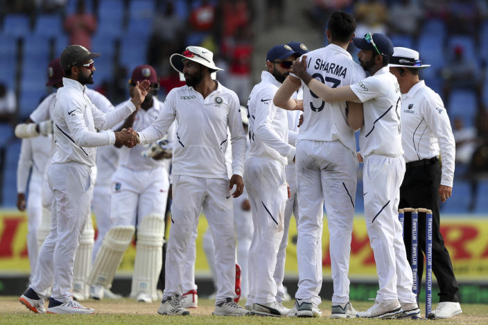 Players of India celebrate beating West Indies by 318 runs at the end of day four of the first Test cricket match at the Sir Vivian Richards cricket ground in North Sound, Antigua and Barbuda, Sunday, Aug. 25, 2019. (AP Photo/Ricardo Mazalan)