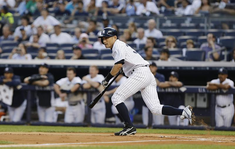 New York Yankees' Ichiro Suzuki, of Japan, follows through on a single for his 4,000th career hit in Japan and the major leagues, during the first inning of a baseball game against the Toronto Blue Jays Wednesday, Aug. 21, 2013, in New York. (AP Photo/Frank Franklin II)