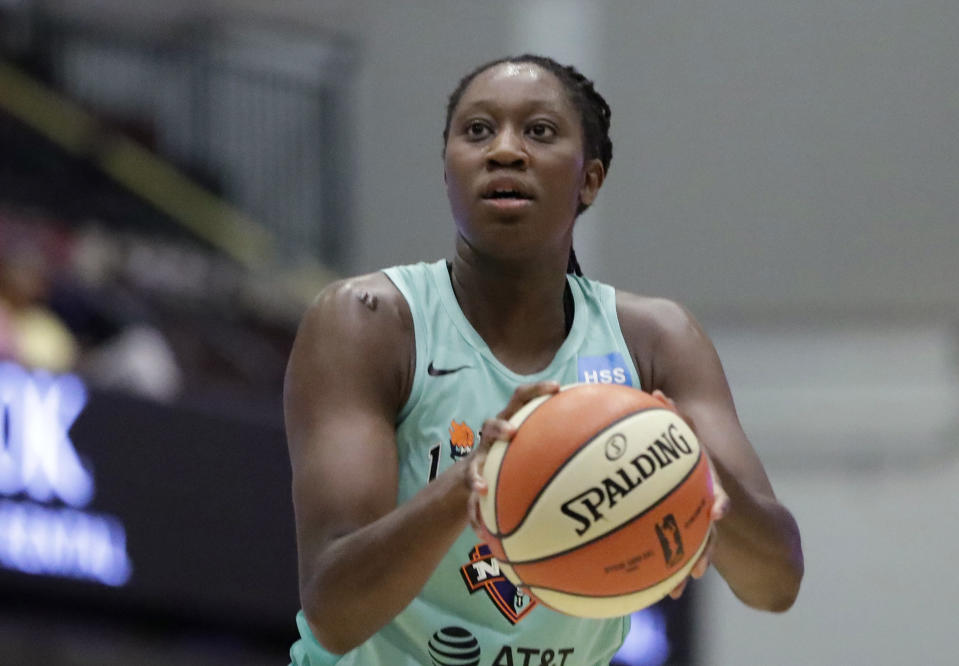 FILE - In this Aug. 13, 2019, file photo, New York Liberty center Tina Charles shoots a free throw during the first half of a WNBA basketball game in White Plains, N.Y. Charles, now with the Washington Mystics, is waiting to have her case heard by the league's independent panel of doctors to see if she'll be medically excused for the season. (AP Photo/Kathy Willens, File)
