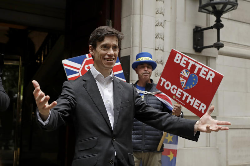 British ruling Conservative party leadership and Prime Minister contender Rory Stewart reacts to seeing awaiting media as he leaves television news network studios in London, Wednesday, June 19, 2019. Britain's Conservative Party are set to kick one more candidate out of the contest to become the country's next prime minister, as rivals scramble to catch front-runner Boris Johnson. The five-strong field will be narrowed in elimination votes by Tory lawmakers Wednesday and Thursday, with the two top candidates going to a runoff of party members across the country. (AP Photo/Matt Dunham)