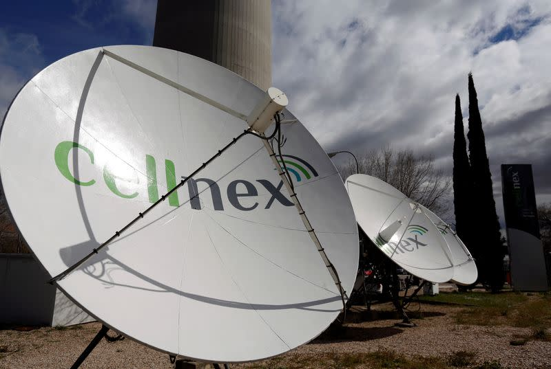 """FILE PHOTO: Telecom antennas of SpainÕs telecoms infrastructures firm Cellnex are seen under main telecom tower, known as """"Piruli"""", in Madrid"""