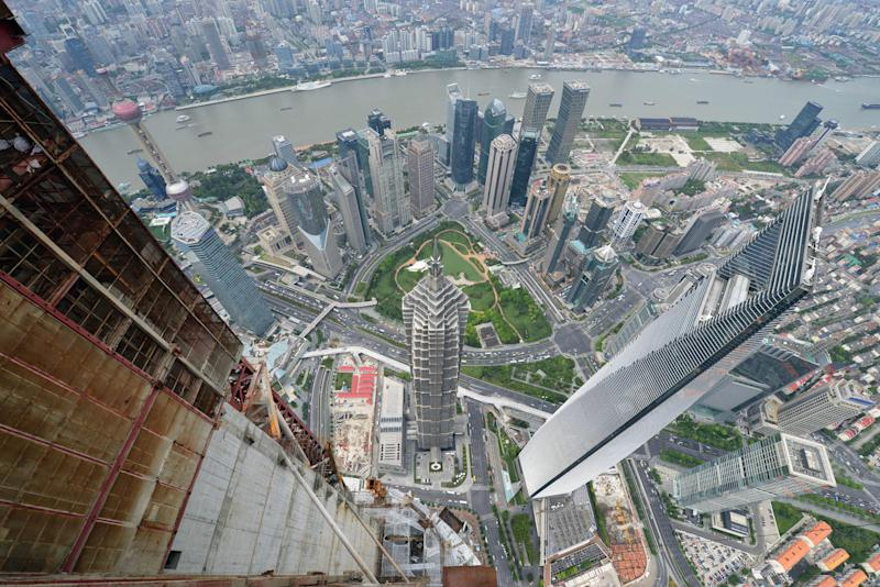 China's gross domestic product (GDP) expanded in the third quarter at its slowest pace since the depths of the global financial crisis, official data showed, but analysts said the world's second-largest economy may have bottomed out (AFP Photo/Peter Parks)