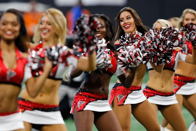 <p>Atlanta Falcons cheerleaders perform during the first half against the Minnesota Vikings at Mercedes-Benz Stadium on December 3, 2017 in Atlanta, Georgia. (Photo by Kevin C. Cox/Getty Images) </p>