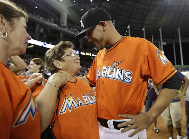 Miami Marlins starting pitcher Jose Fernandez, right, talks with his grandmother Olga Fernandez, of Cuba, center, and mother Maritza Fernandez, left, of Miami, following the Marlins' 10-1 victory over the Colorado Rockies in an opening day baseball game, Monday, March 31, 2014, in Miami. (AP Photo/Lynne Sladky)