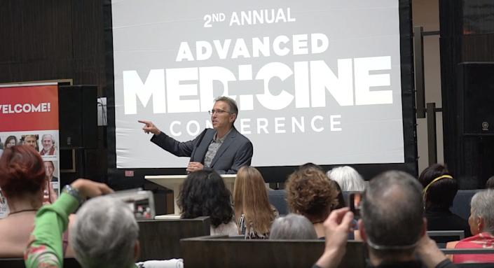 Homeopathic practitioner Robert Bell speaks at the Advanced Medicine Conference.