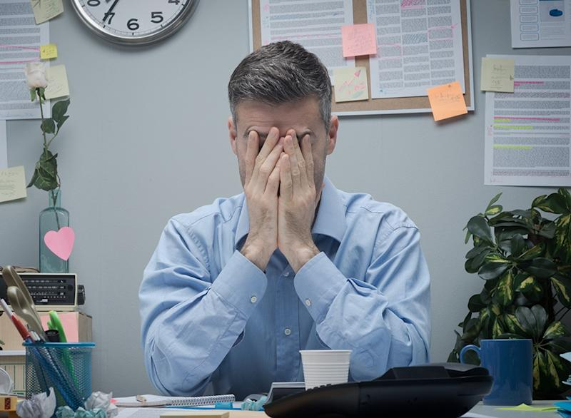 tired man in office