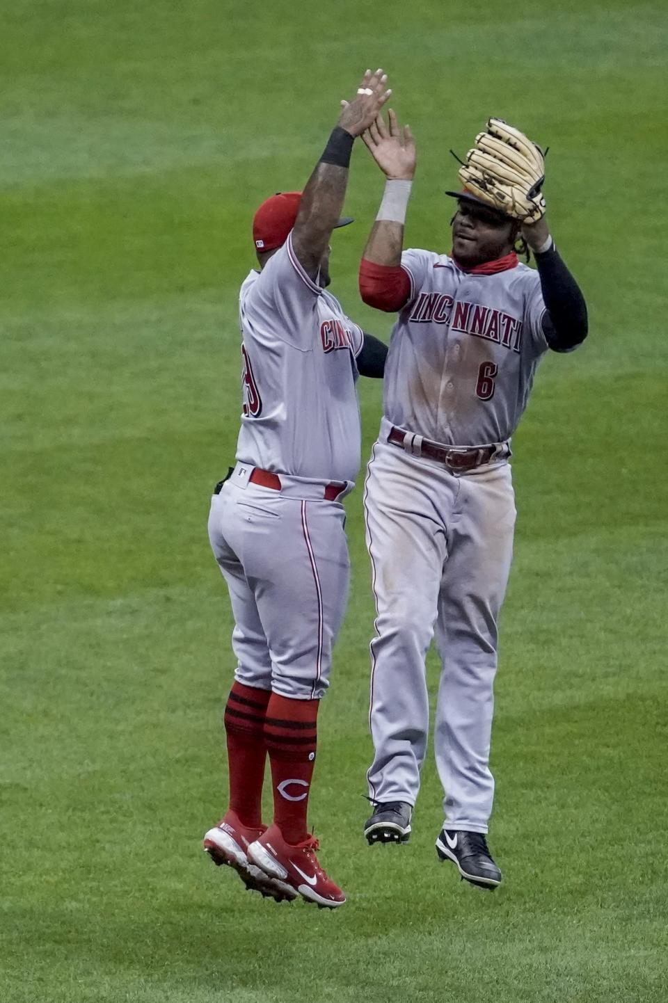 Cincinnati Reds' Phillip Ervin and Christian Colon celebrate after a baseball game against the Milwaukee Brewers Friday, Aug. 7, 2020, in Milwaukee. The Reds won 8-3. (AP Photo/Morry Gash)
