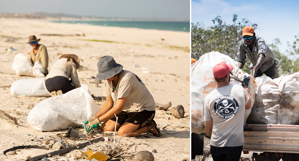 Volunteers pick up rubbish and put it into sacks on the beach on the left. A man with a Sea Shepherd logo on his shirt hands a sack of rubbish to an Indigenous ranger on the back of a ute on the right.