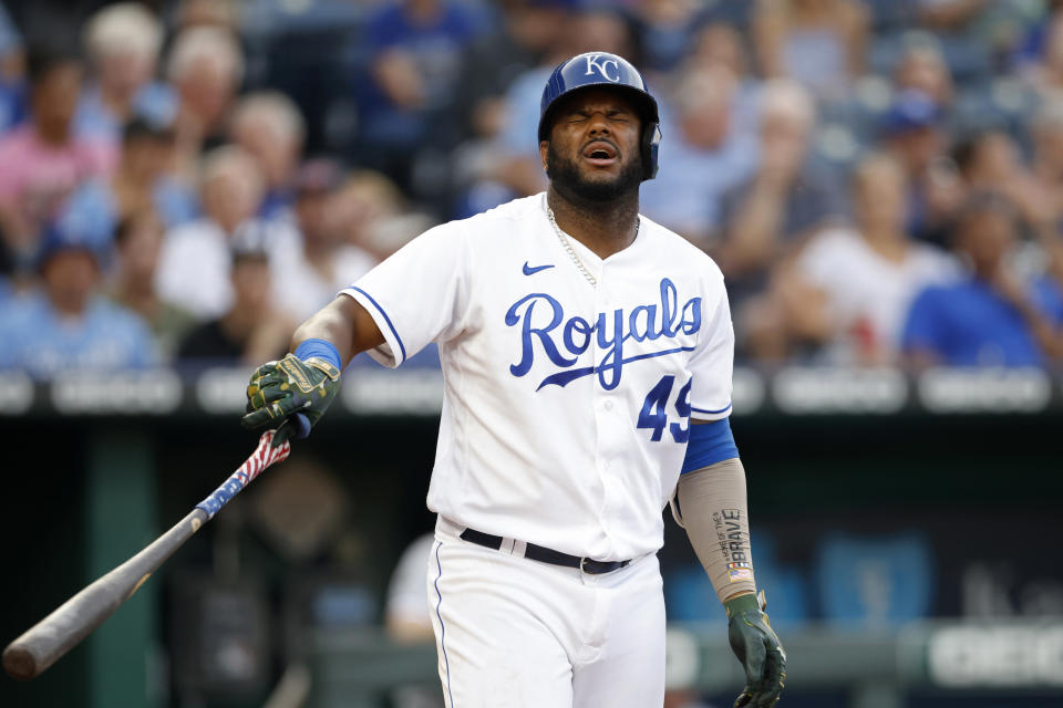 Kansas City Royals' Hanser Alberto reacts after getting hit by a pitch during the third inning of a baseball game against the Chicago White Sox at Kauffman Stadium in Kansas City, Mo., Monday, July 26, 2021. (AP Photo/Colin E. Braley)
