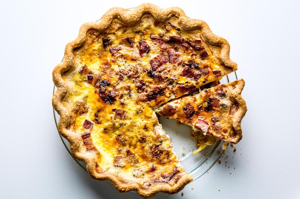"""Buttery, bacon-y, and custardy, with a very tender, rich crust (thanks to the combination of butter and lard). <a href=""""https://www.bonappetit.com/recipe/bas-best-quiche-lorraine?mbid=synd_yahoo_rss"""" rel=""""nofollow noopener"""" target=""""_blank"""" data-ylk=""""slk:See recipe."""" class=""""link rapid-noclick-resp"""">See recipe.</a>"""