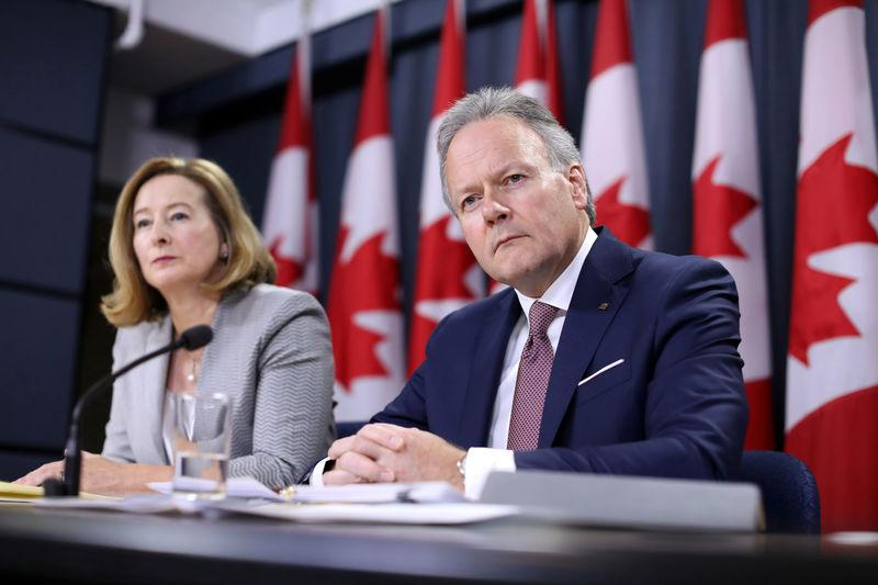 Bank of Canada Governor Stephen Poloz and Senior Deputy Governor Carolyn Wilkins listen to a question during a news conference in Ottawa