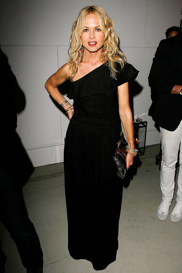 "Instead of wearing a voluminous caftan like she usually does, Rachel Zoe opts for a pretty one-shoulder black gown that compliments her tiny figure. Jeff Vespa/<a href=""http://www.wireimage.com"" target=""new"">WireImage.com</a> - April 23, 2009"