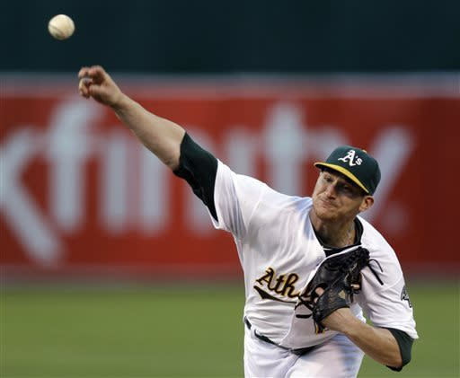 Oakland Athletics' Jarrod Parker works against the Seattle Mariners in the first inning of a baseball game Tuesday, April 2, 2013, in Oakland, Calif. (AP Photo/Ben Margot)