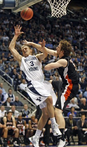 BYU guard Tyler Haws (3) is fouled by Mercer forward Bud Thomas (5) during a second-round game of the NIT college basketball tournament on Monday, March 25, 2013, in Provo, Utah. (AP Photo/The Deseret News, Tom Smart)