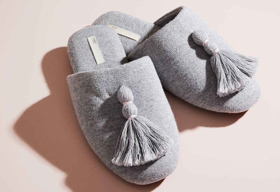 """<p><a href=""""https://www.popsugar.com/buy/Skin-Worldwide-Vara-Slipper-Heather-Gray-531152?p_name=Skin%20Worldwide%20Vara%20Slipper%20in%20Heather%20Gray&retailer=skinworldwide.com&pid=531152&price=80&evar1=casa%3Aus&evar9=47010791&evar98=https%3A%2F%2Fwww.popsugar.com%2Fhome%2Fphoto-gallery%2F47010791%2Fimage%2F47010865%2FSkin-Worldwide-Vara-Slipper-in-Heather-Gray&list1=shopping%2Cgifts%2Cneiman%20marcus%2Choliday%2Cmust%20have%20box%2Cpast%20boxes&prop13=api&pdata=1"""" rel=""""nofollow noopener"""" class=""""link rapid-noclick-resp"""" target=""""_blank"""" data-ylk=""""slk:Skin Worldwide Vara Slipper in Heather Gray"""">Skin Worldwide Vara Slipper in Heather Gray</a> ($80)</p> <p>Slide your feet into these soft, plush slippers when you're relaxing at home. The machine-washable design will be perfect for the Winter months ahead. The fabric includes moisture-wicking nanoparticles of jade woven into it. Get ready to feel less stressed as soon as you slip these on.</p> <p><strong>Essentials We Also Love:</strong> <a href=""""https://www.popsugar.com/buy/Terra-Chemise-531161?p_name=Terra%20Chemise&retailer=skinworldwide.com&pid=531161&price=126&evar1=casa%3Aus&evar9=47010791&evar98=https%3A%2F%2Fwww.popsugar.com%2Fhome%2Fphoto-gallery%2F47010791%2Fimage%2F47010865%2FSkin-Worldwide-Vara-Slipper-in-Heather-Gray&list1=shopping%2Cgifts%2Cneiman%20marcus%2Choliday%2Cmust%20have%20box%2Cpast%20boxes&prop13=api&pdata=1"""" rel=""""nofollow noopener"""" class=""""link rapid-noclick-resp"""" target=""""_blank"""" data-ylk=""""slk:Terra Chemise"""">Terra Chemise</a> ($126) and <a href=""""https://www.popsugar.com/buy/French-Terry-Robe-531162?p_name=French%20Terry%20Robe&retailer=skinworldwide.com&pid=531162&price=170&evar1=casa%3Aus&evar9=47010791&evar98=https%3A%2F%2Fwww.popsugar.com%2Fhome%2Fphoto-gallery%2F47010791%2Fimage%2F47010865%2FSkin-Worldwide-Vara-Slipper-in-Heather-Gray&list1=shopping%2Cgifts%2Cneiman%20marcus%2Choliday%2Cmust%20have%20box%2Cpast%20boxes&prop13=api&pdata=1"""" rel=""""nofollow noopener"""" class=""""link rapid-noclick-r"""