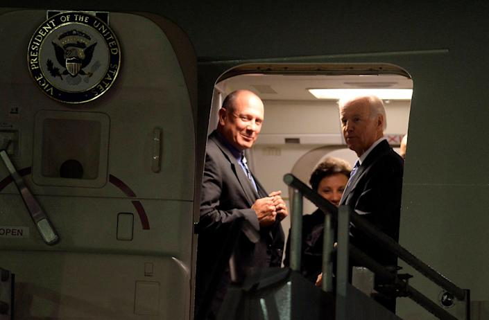 US Vice President Joe Biden (R) alights from the plane upon arrival at the Benito Juarez international airport in Mexico City, on September 19, 2013 for a one-day official visit.