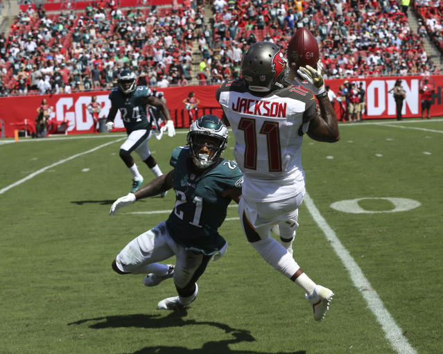 <p>Tampa Bay Buccaneers wide receiver DeSean Jackson (11) grabs a pass over Philadelphia Eagles cornerback Ronald Darby (21), during the second half of an NFL football game, Sunday, Sept. 16, 2018, in Tampa, Fla. (AP Photo/Mark LoMoglio) </p>