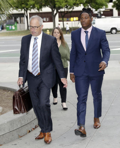 San Francisco 49ers linebacker Reuben Foster, right, arrives with his attorney Joshua Bentley at Santa Clara County Superior Court Thursday, May 17, 2018, in San Jose, Calif. Foster pleaded not guilty Tuesday, May 8, 2018, to charges stemming from allegations that he attacked his then-girlfriend in their home in February. A preliminary hearing has been scheduled today, at which point Foster's former girlfriend, Elissa Ennis, may testify under oath. (AP Photo/Marcio Jose Sanchez)