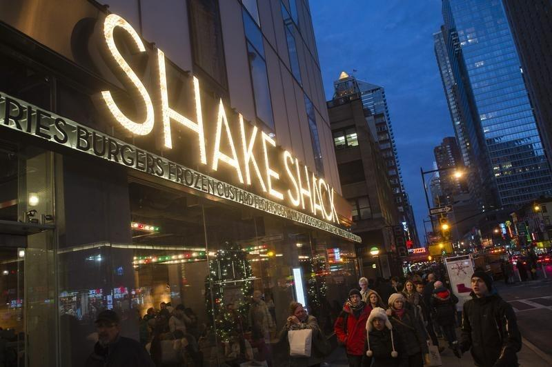Passersby walk in front of the Shake Shack restaurant in the Manhattan borough of New York