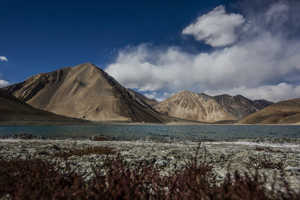 Mountains rise over the Pangong Lake in Ladakh, India.