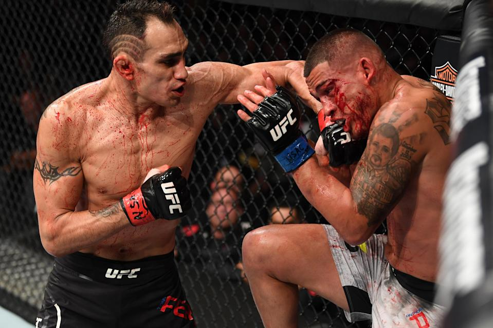 Tony Ferguson punches Anthony Pettis in their lightweight bout during the UFC 229 event inside T-Mobile Arena on Oct. 6, 2018 in Las Vegas, Nevada. (Photo by Josh Hedges/Zuffa LLC/Zuffa LLC)
