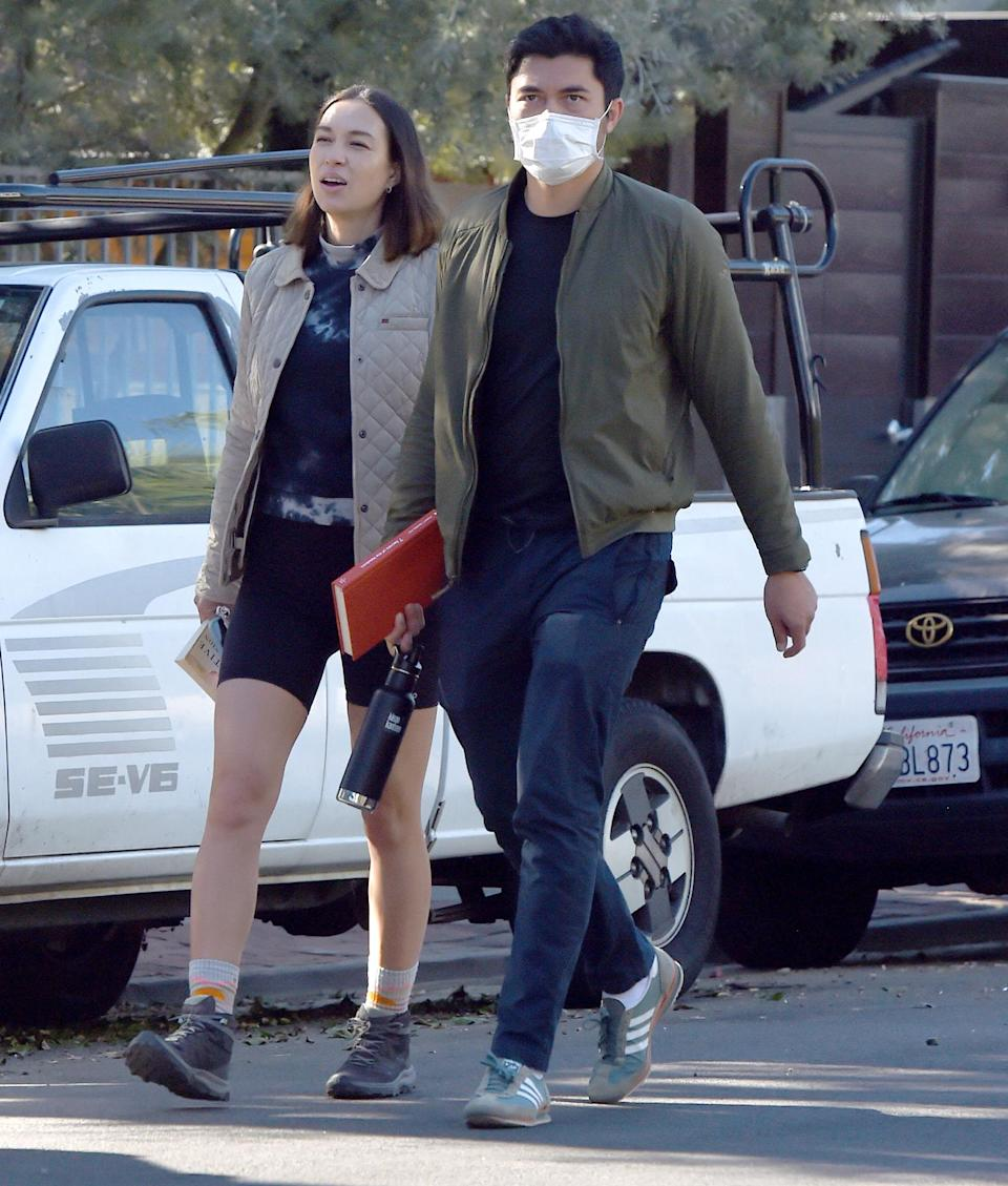 <p>Parents-to-be Liv Lo and Henry Golding go for an afternoon walk on Tuesday in L.A.</p>