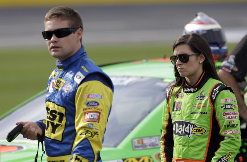 "FILE - In this May 17, 2013 file photo, Danica Patrick, right, walks with Ricky Stenhouse Jr., left, on pit road during qualifying for the NASCAR Sprint Showdown auto race at Charlotte Motor Speedway in Concord, N.C. Patrick says there were some ""silent moments"" on the way home from Sunday's May 26, 2013 Coca-Cola 600 after Stenhouse drove his car into the side of his girlfriend's car and ended her race. It was the first run-in for the NASCAR rookies since they announced in February they were dating. (AP Photo/Chuck Burton, File)"