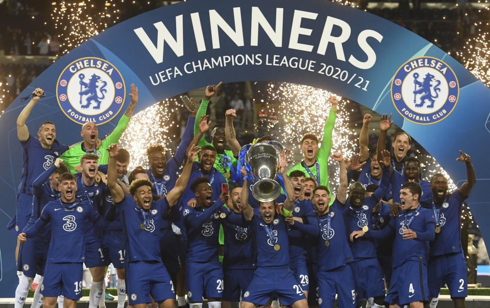 Chelsea players celebrate with the trophy after winning the Champions League.